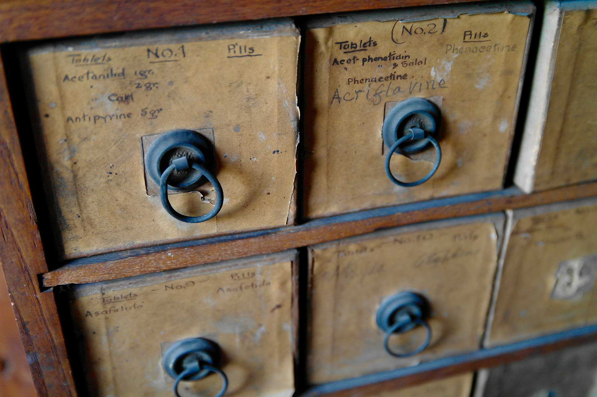 antique wooden drawers used by a pharmacist