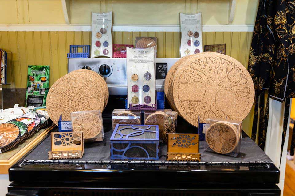 a booth of a local artisan showing intricate wood and cork designs