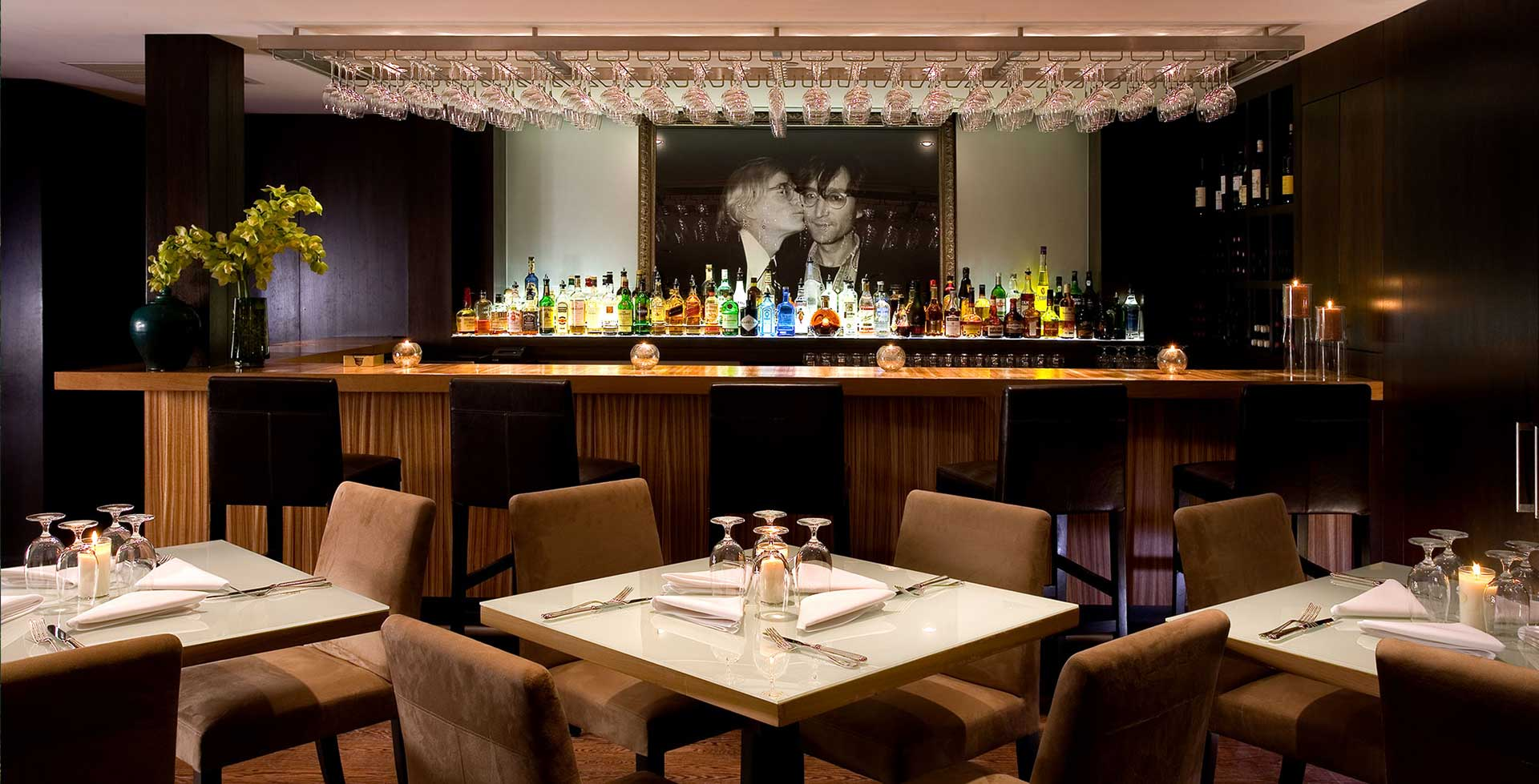 bar louis' bar and liquor selection with seated tables in front