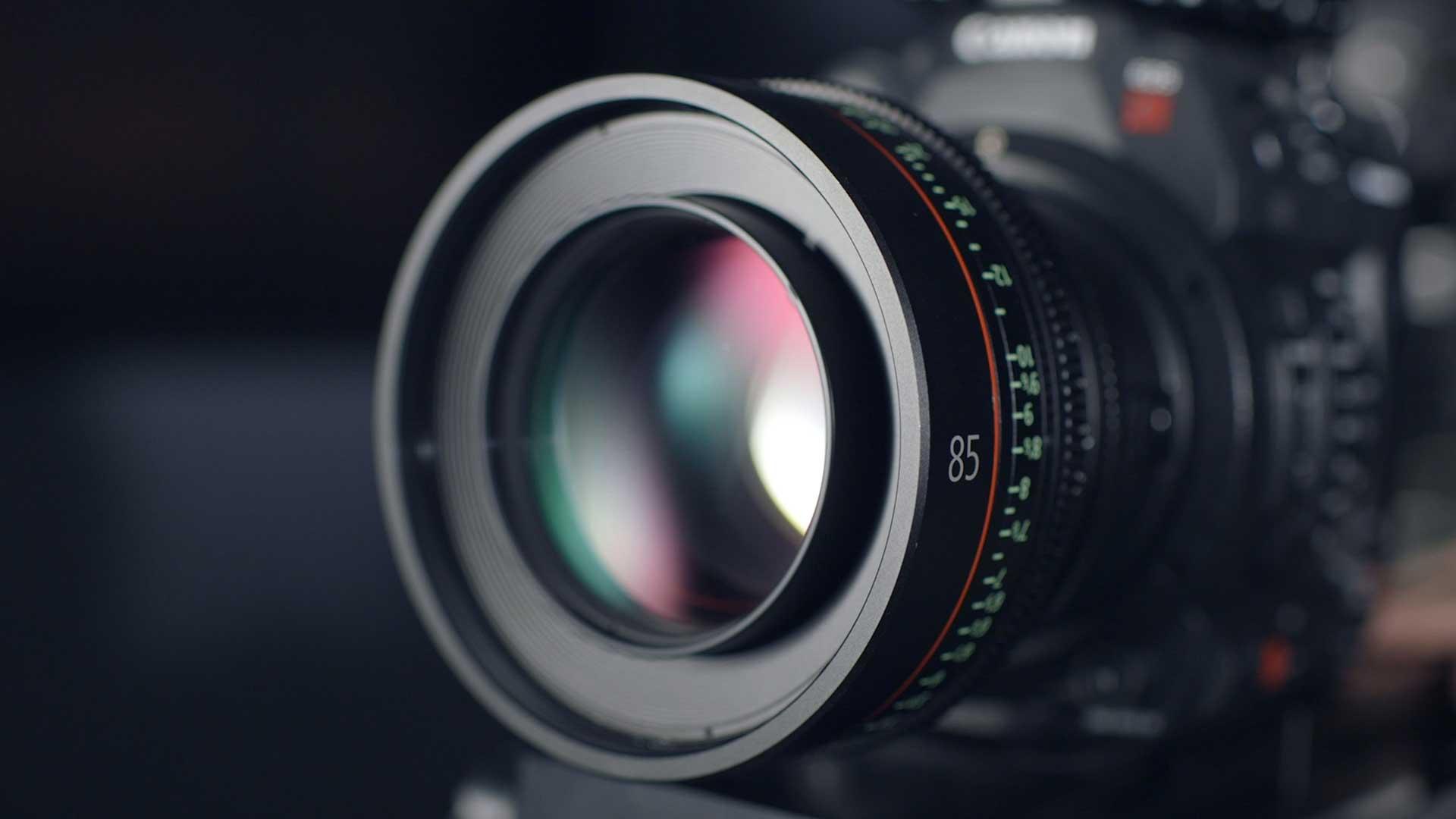 close up of a dslr camera lens on a black canon camera
