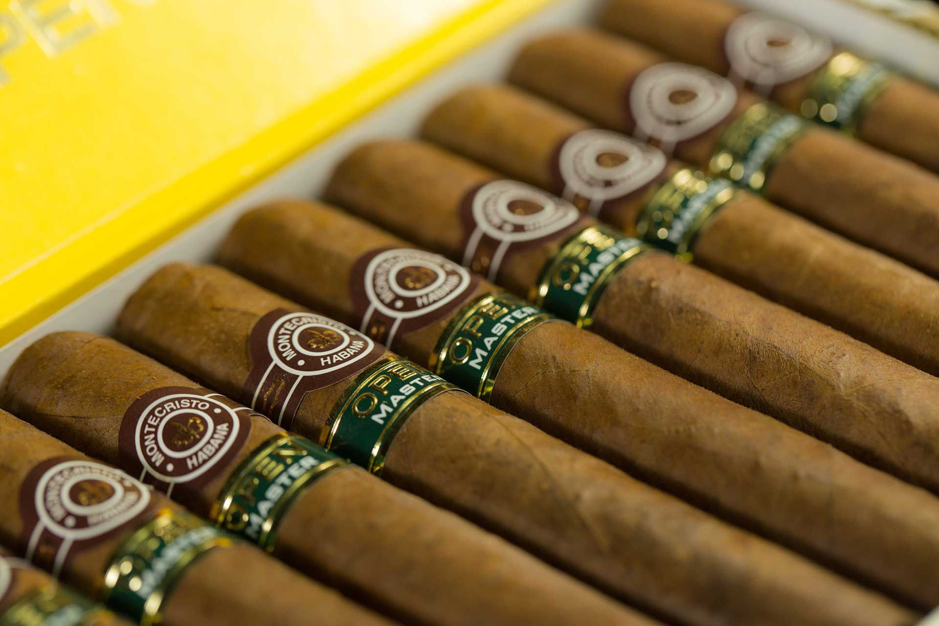a row of cigars in the box