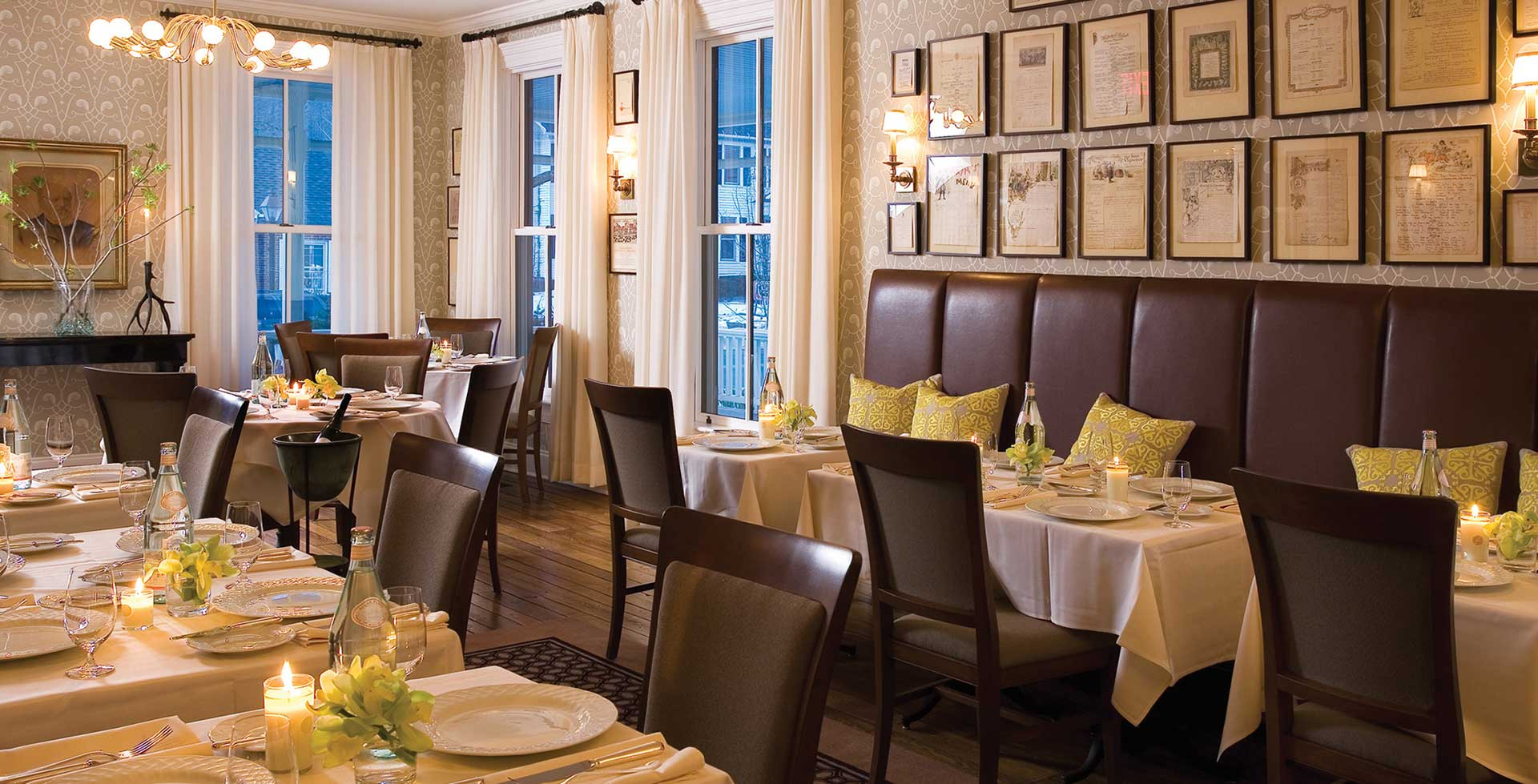 interior of the delmonico room dining area with tables and a booth at hotel fauchere