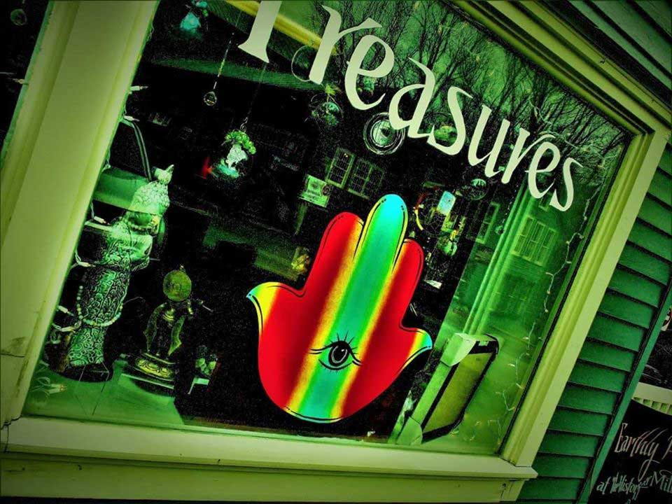 the shop window of earthly treasures showing artwork and product for sale