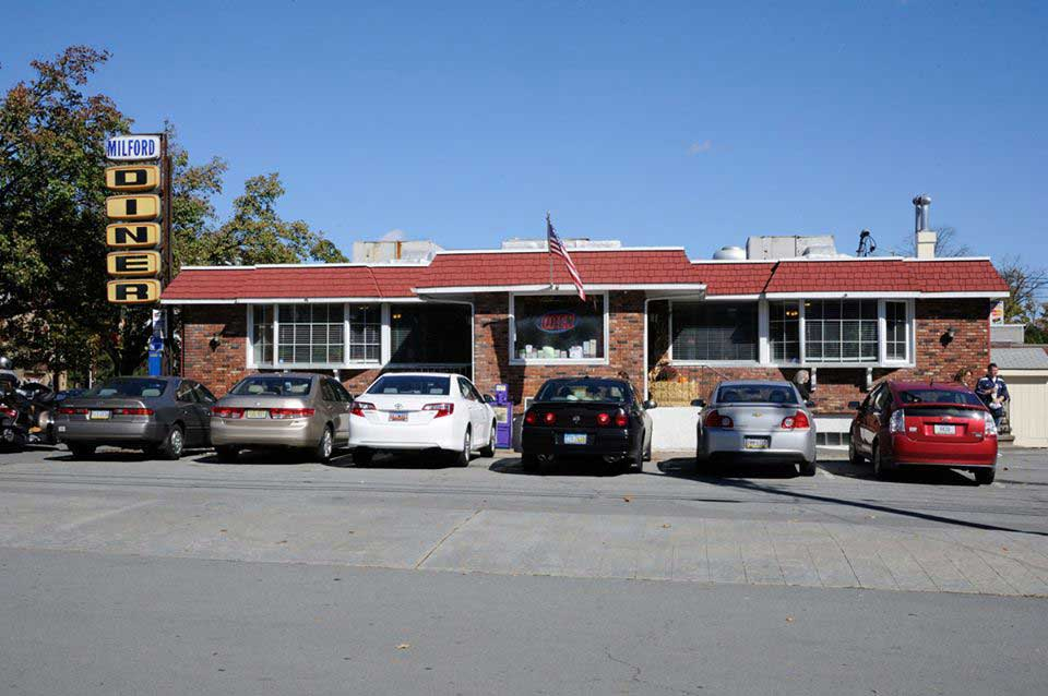 the front of the milford diner with cars parked out front