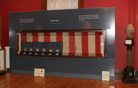 museum display of the lincoln flag with a bust of abraham lincoln