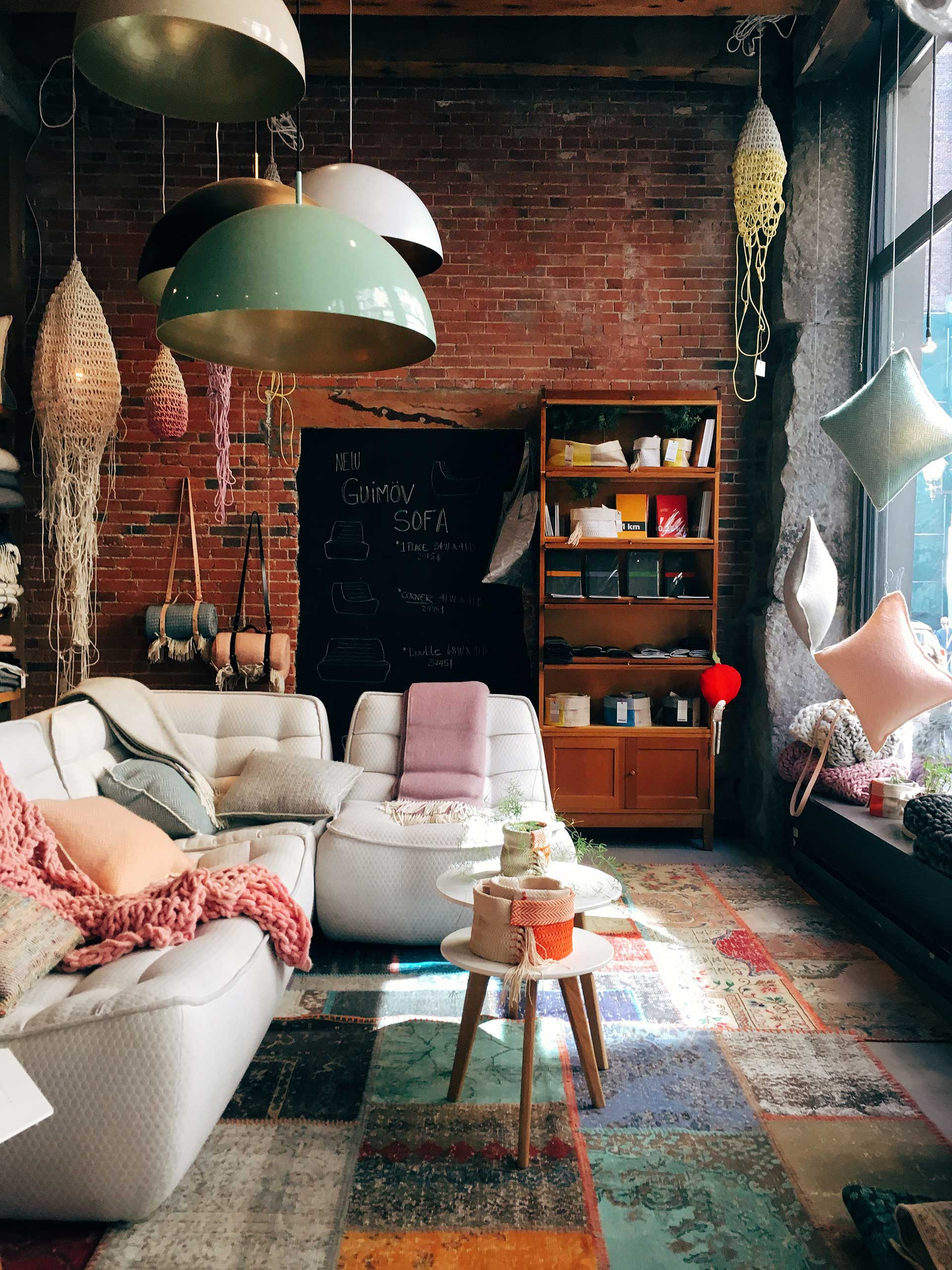 interior of willow boutique with unique chairs, pillows, and lighting