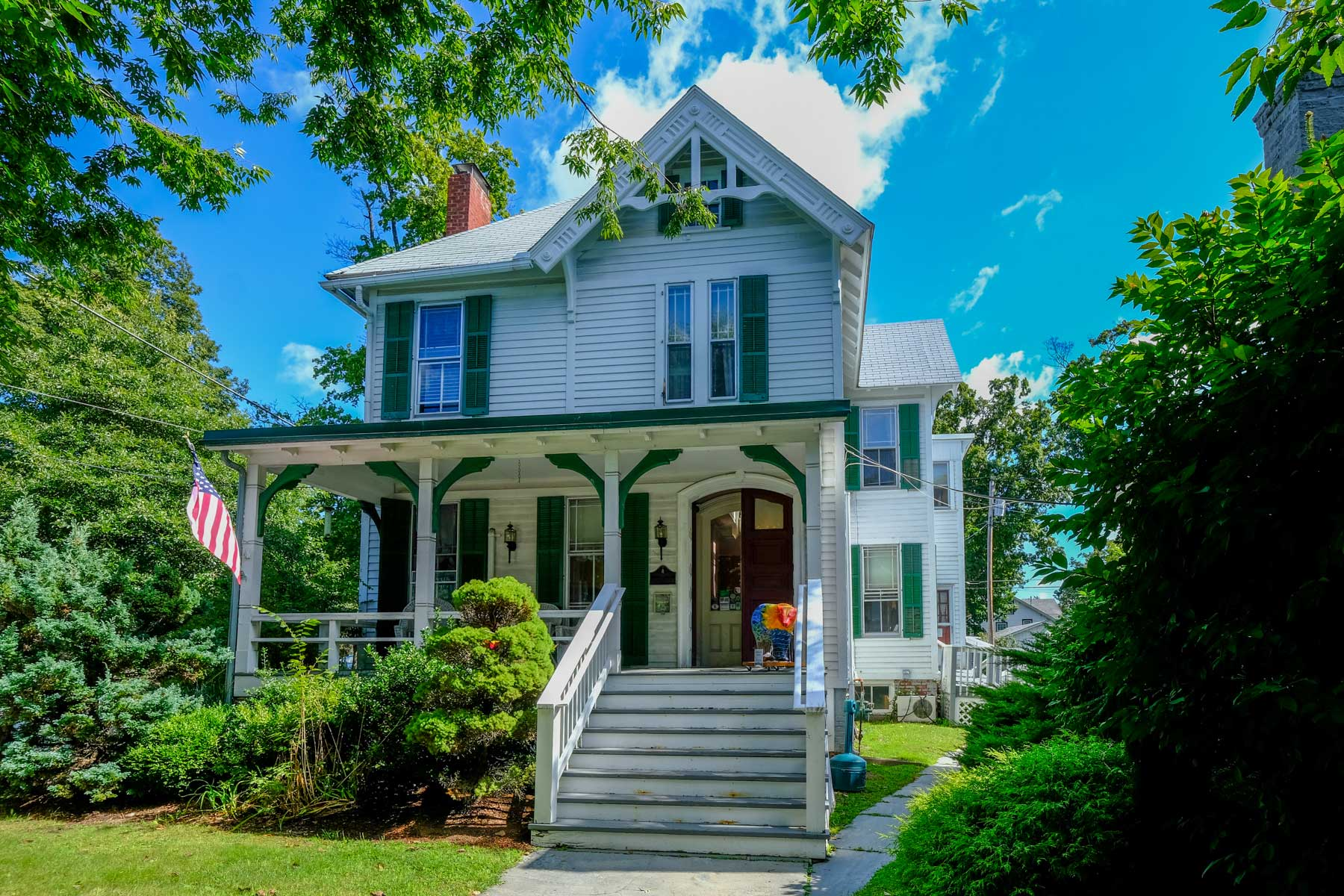 historic Victorian house with green shutters