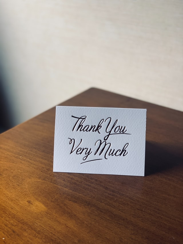 thank you card on wooden table