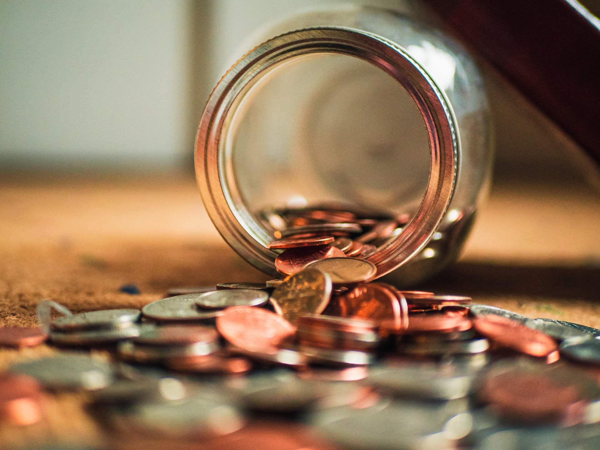 coins spilling out of a jar