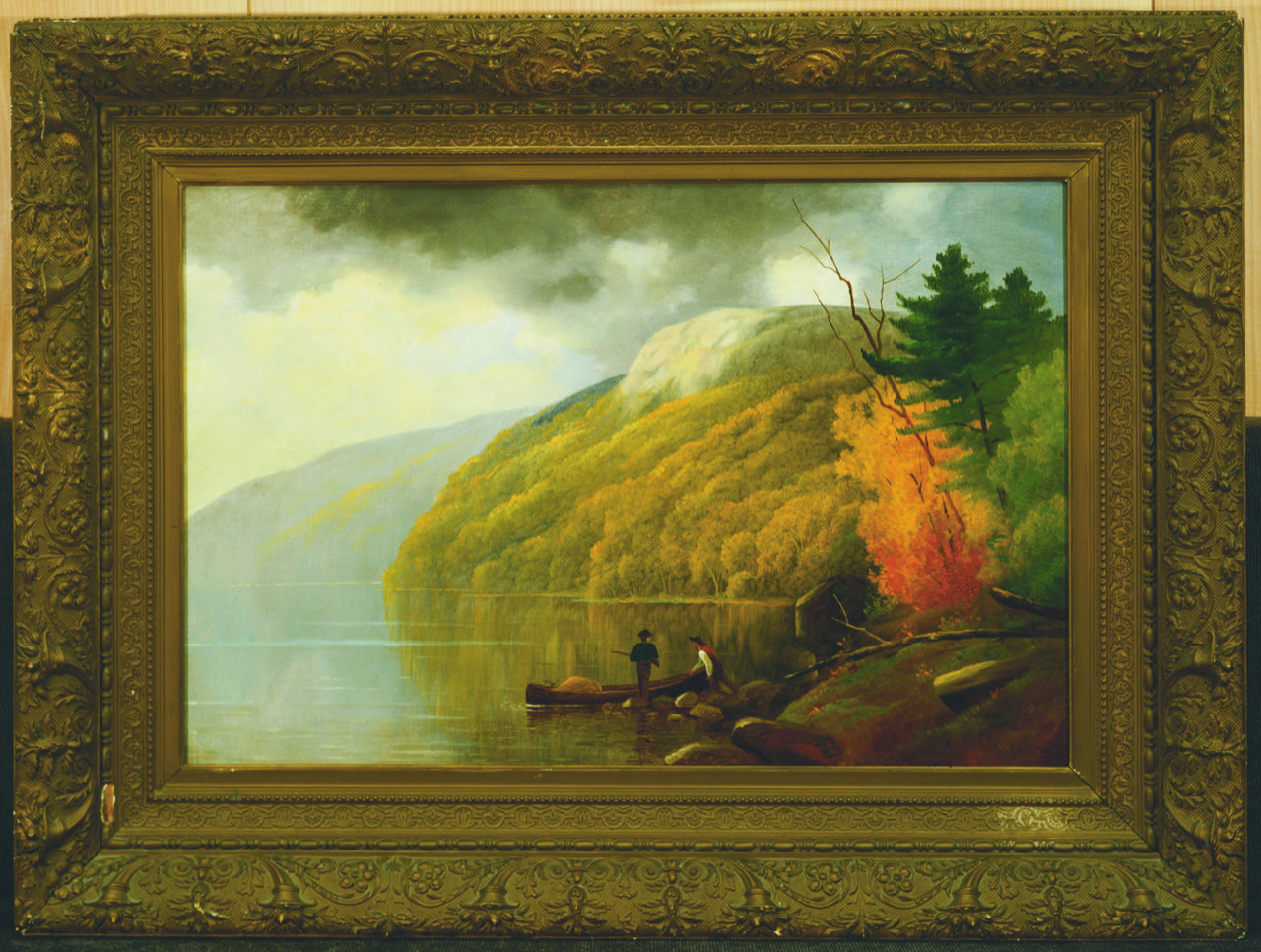 a framed painting of nature