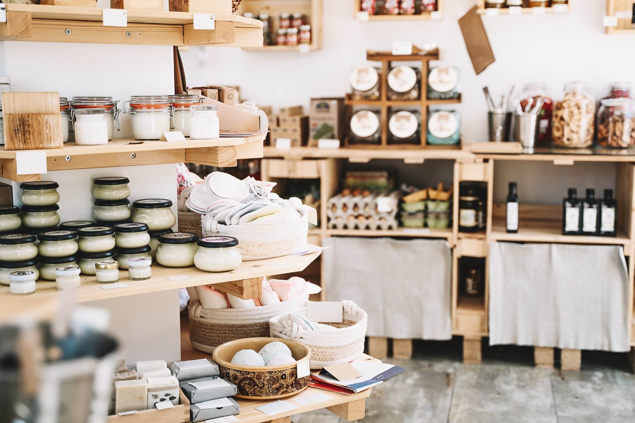 the brightly lit interior of an eco-friendly store with various products on the shelf