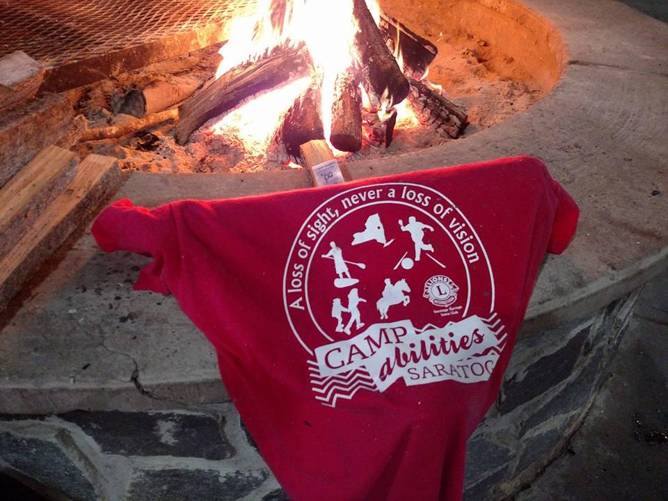 CAS tee shirt near bonfire