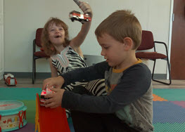 Picture of children playing with toy cars.