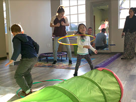 Children playing hula hoop at Milestone Family Solutions