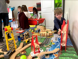 Children playing with toy city at Milestone Family Solutions