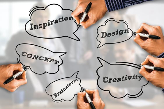 Hands marking down ideas