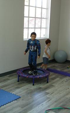 Child on trampoline in the Fun Zone