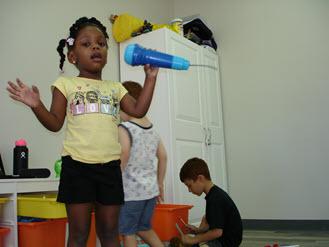 Girl Singing in the Fun Zone