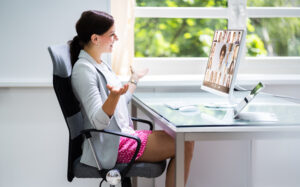Lady comfortable working from home with VoIP communications system from Luminet Solutions