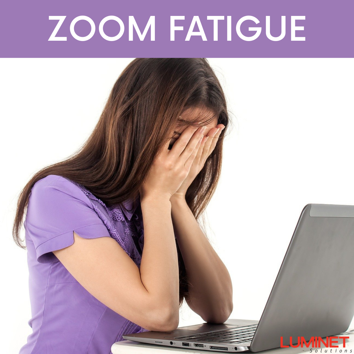 Woman In Purple Outfit In Front Of Her Computer With Her Hands Covering Her Face Due To Zoom Fatigue.