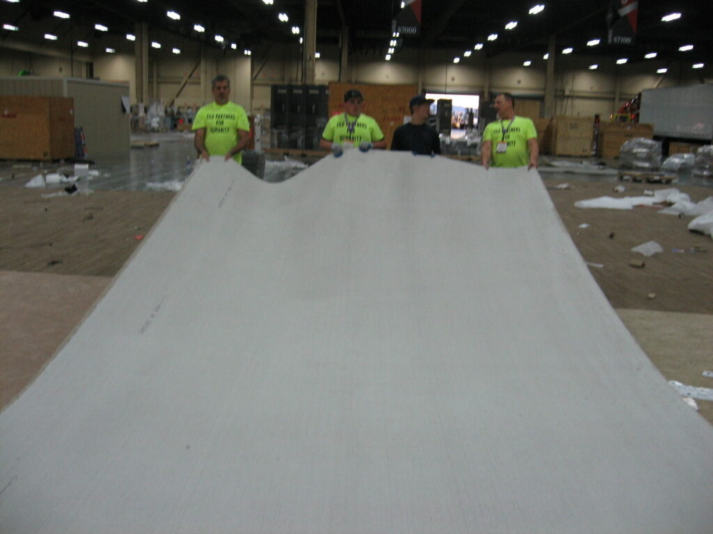 S2 Pic#76 Volunteers collect carpet donated by Beaulieu to Tile Partners for Humanity