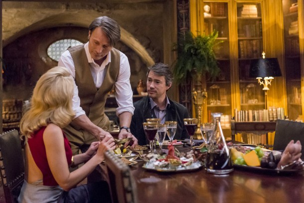 """HANNIBAL -- """"Antipasto"""" Episode 301 -- Pictured: (l-r) Gillian Anderson as Dr. Bedelia Du Maurier, Mads Mikkelsen as Dr. Hannibal Lecter, Tom Wisdom as Anthony Dimmond -- (Photo by: Brooke Palmer/NBC)"""