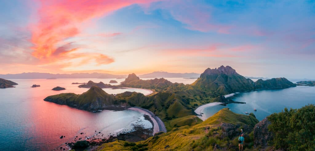 Padar Island Lookout Hike at sunset, see pink sand beach in Komodo while traveling on an Indonesia dive liveaboard