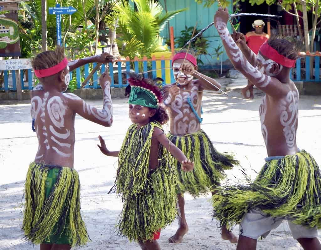 Cultural Papuan Dance performed by children on Arborek Island, Indonesia