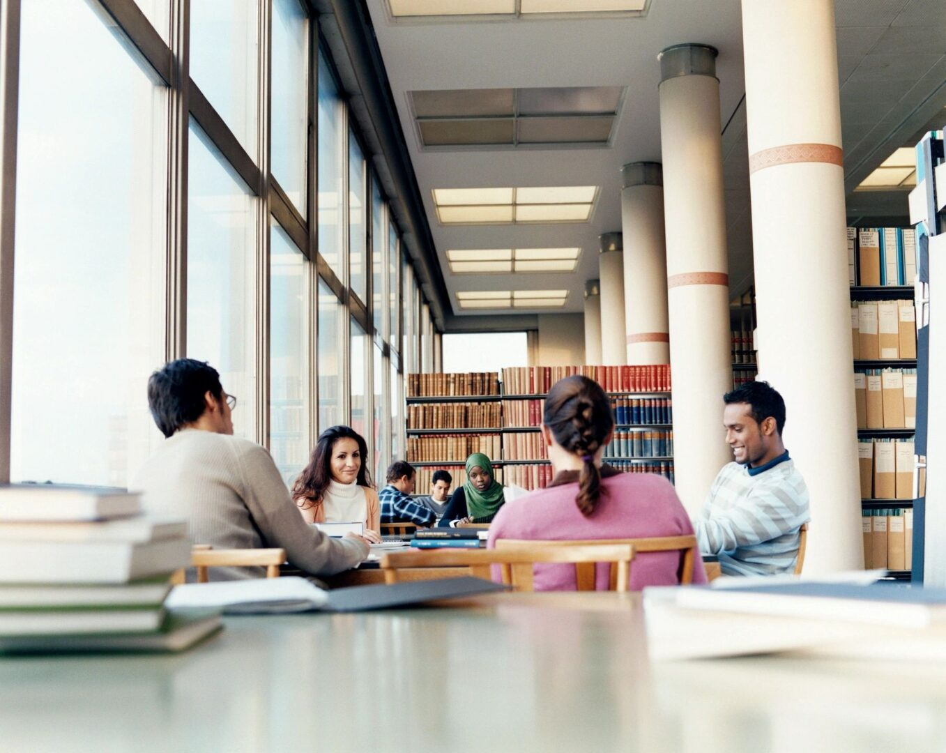 A diverse group of students meeting in a library.