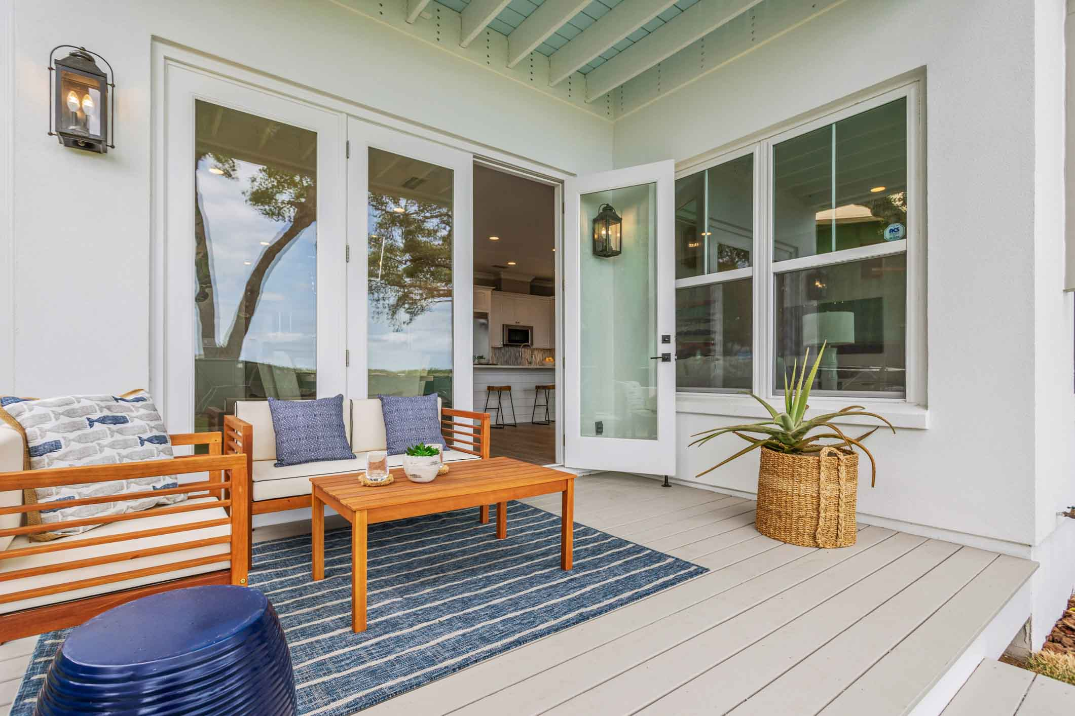 Back porch furniture at a residence at Villa Calissa