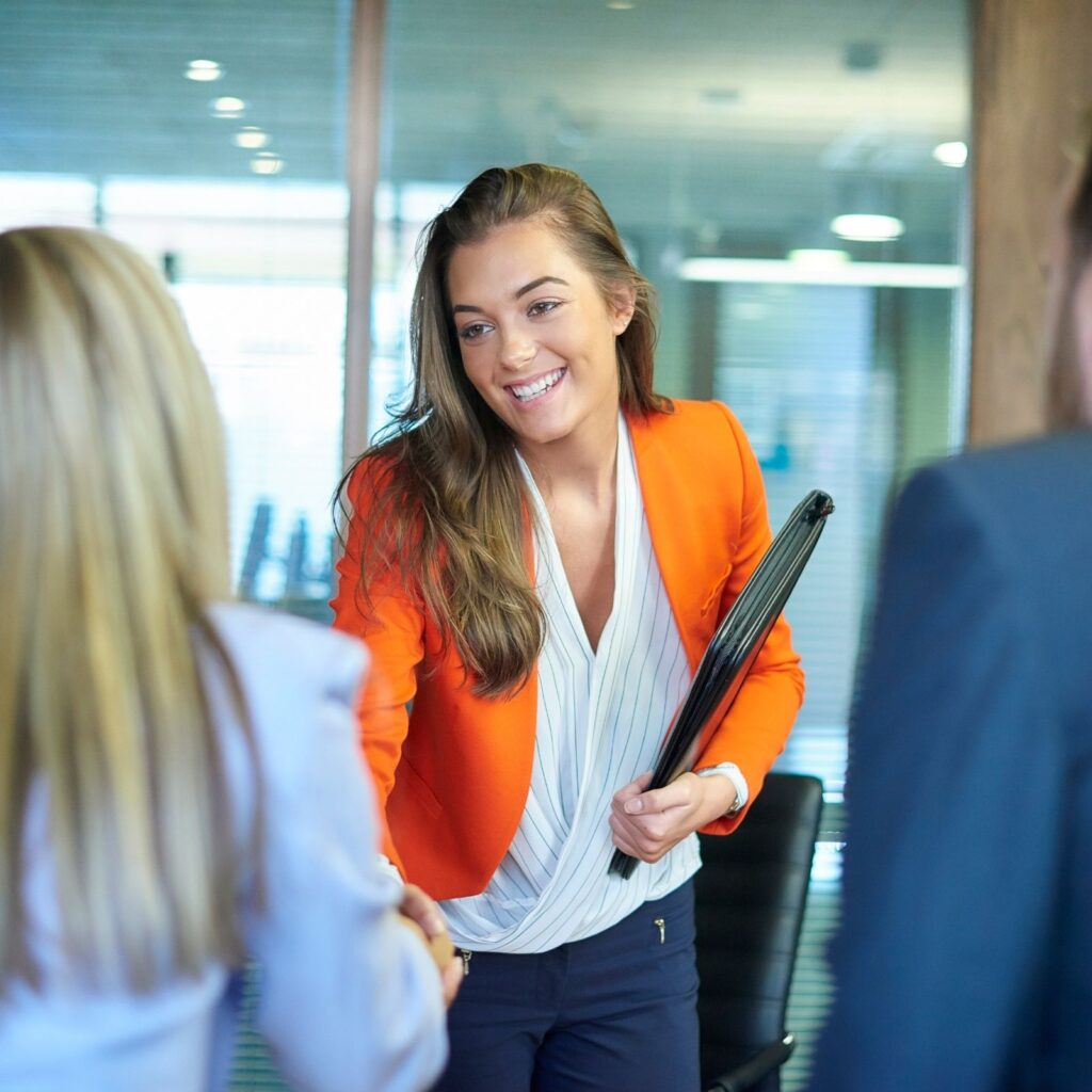 Young Female shaking hands with professionals