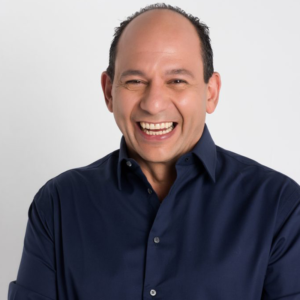 Ralph Pagano smiling behind the scenes photoshoot