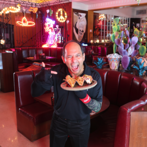 Chef Ralph Pagano showing off his banging tacos at the world famous Naked Taco in South Beach