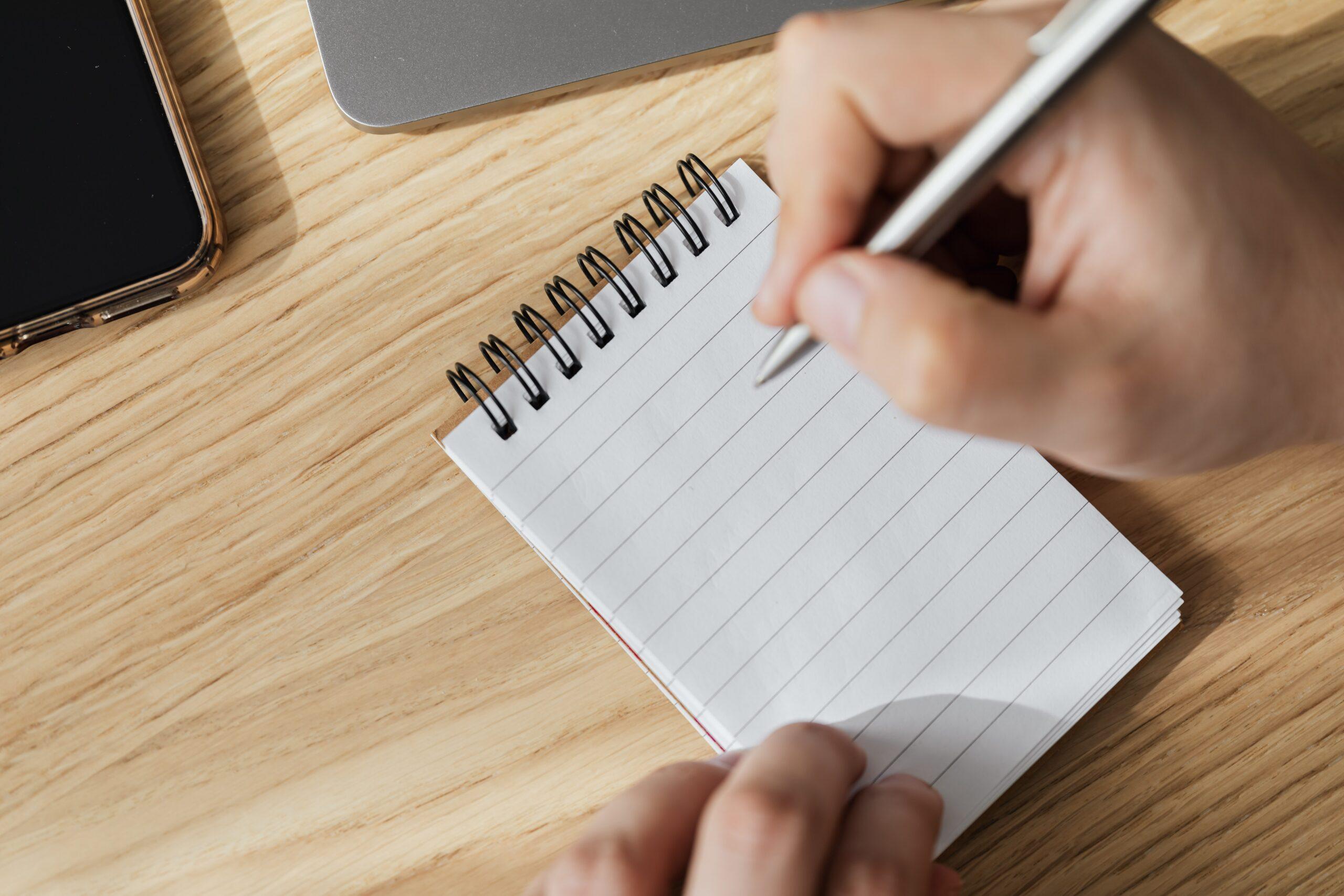 Writing on pad-pexels