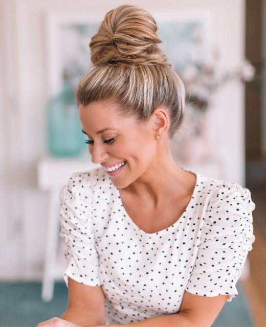 Blogger Olivia Rink with hair in topknot after testing Moroccanoil purple shampoo
