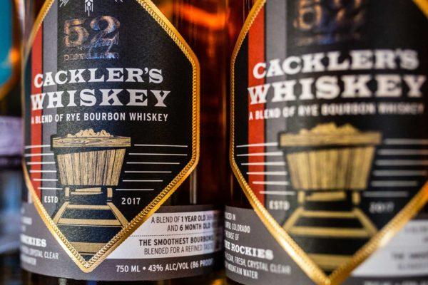 cracklers whiskey bottles shelf