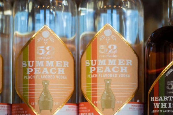 summer peach vodka bottles