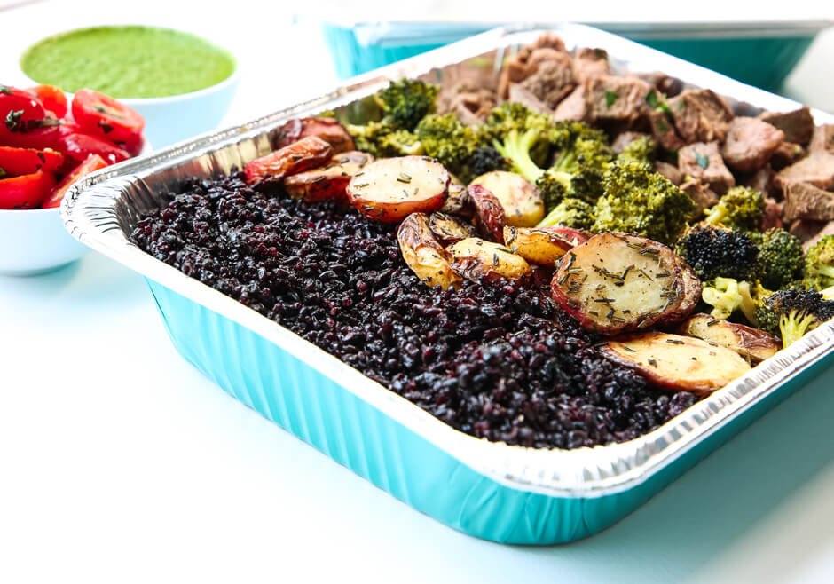 a family take out platter with forbidden rice and other good for you foods