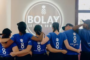 bolay team in front of new sign