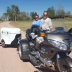 A motorcycle and white cargo trailer