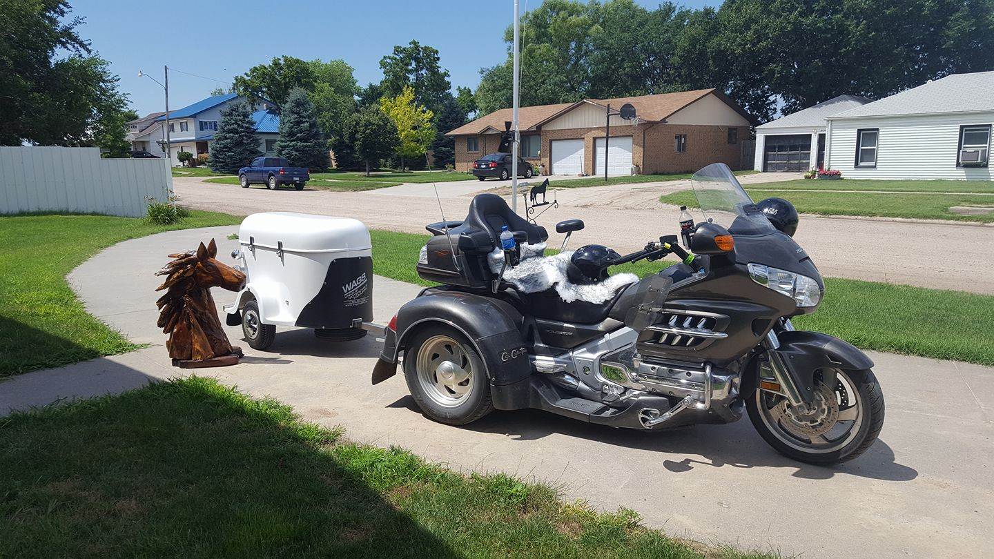 A motorcycle and a white cargo trailer