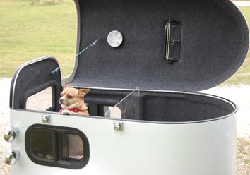 A Chihuahua inside a white cargo trailer