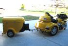 A yellow cargo trailer