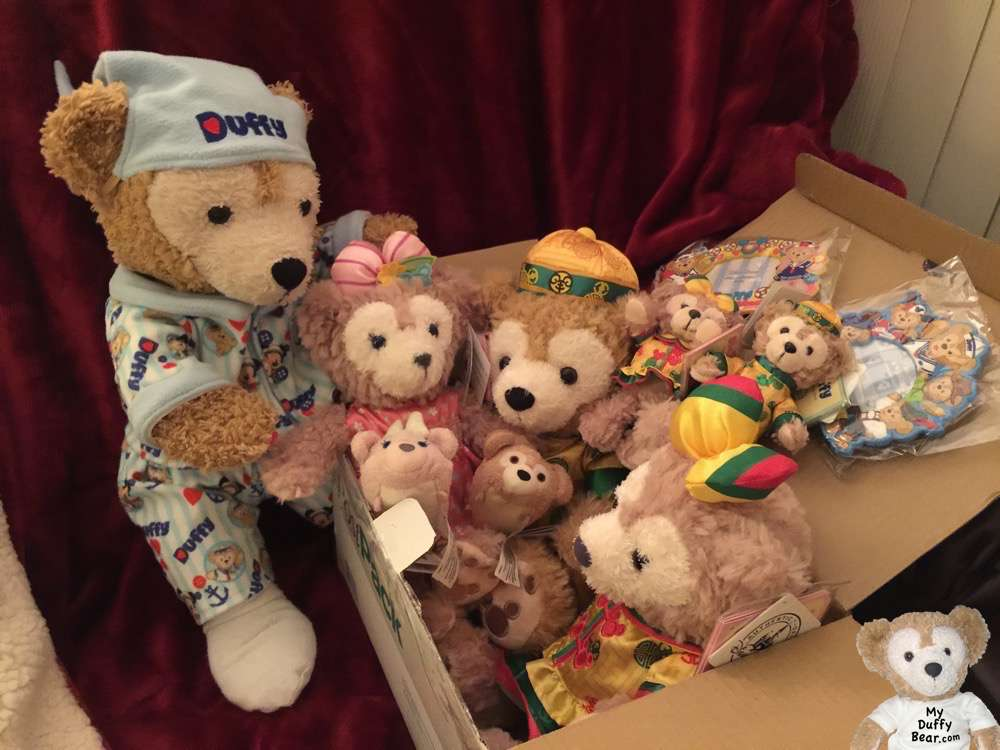 Duffy the Disney Bear opens the boxy from Hong Kong Disneyland.