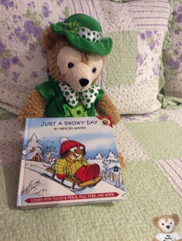 Duffy the Disney Bear reads 'Just a Snowy Day'.