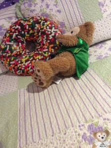 Duffy the Disney Bear eat a super huge chocolate sprinkle donut that's even bigger than he is!