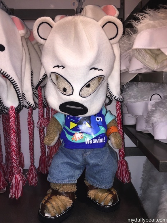 Duffy the Disney Bear puts an oversized Polar Bear hat on his head