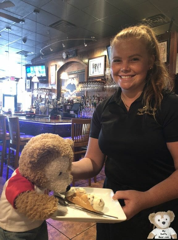 Duffy the Disney Bear jumps up from his seat for his cannoli before the waitress even put the plate down!
