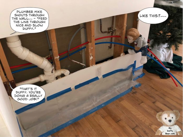 Duffy the Disney Bear learning how to repipe a house with Brevard's Best Plumbing