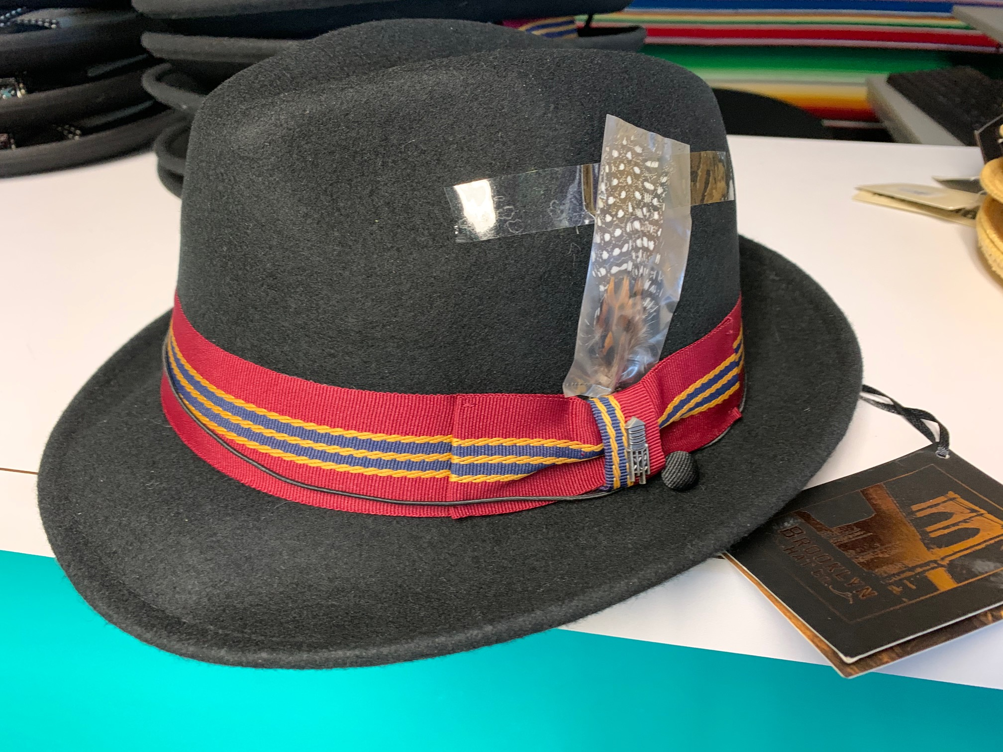 Black Gangster Hat w/Red, Gold, Navy Band